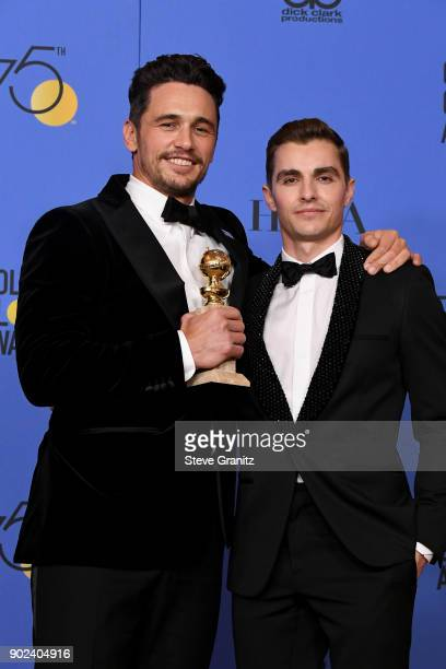 Actor/filmmaker James Franco winner of the award for Best Performance by an Actor in a Motion Picture for 'The Disaster Artist' poses with actor Dave...