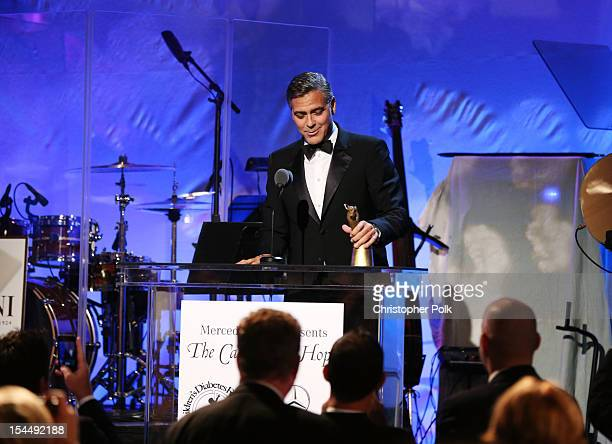Actor/honoree George Clooney speaks onstage during the 26th Anniversary Carousel Of Hope Ball presented by MercedesBenz at The Beverly Hilton Hotel...