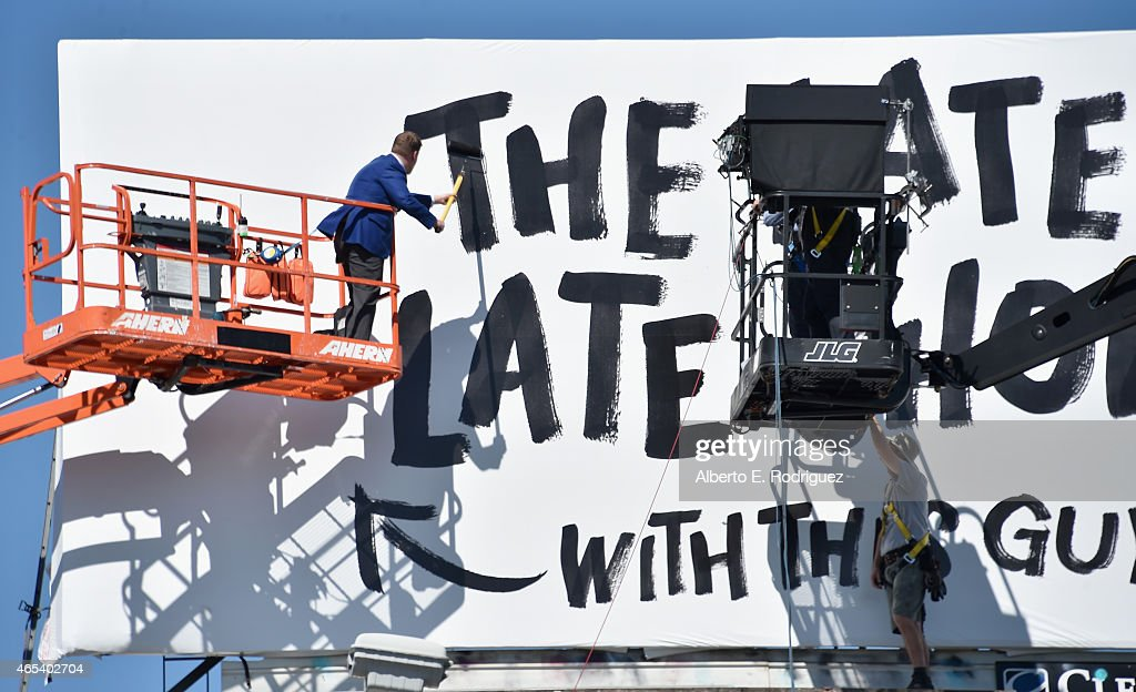 Actor/host James Corden puts up his own billboard for CBS Television Network's 'The Late Late Show' on March 6, 2015 in Los Angeles, California.