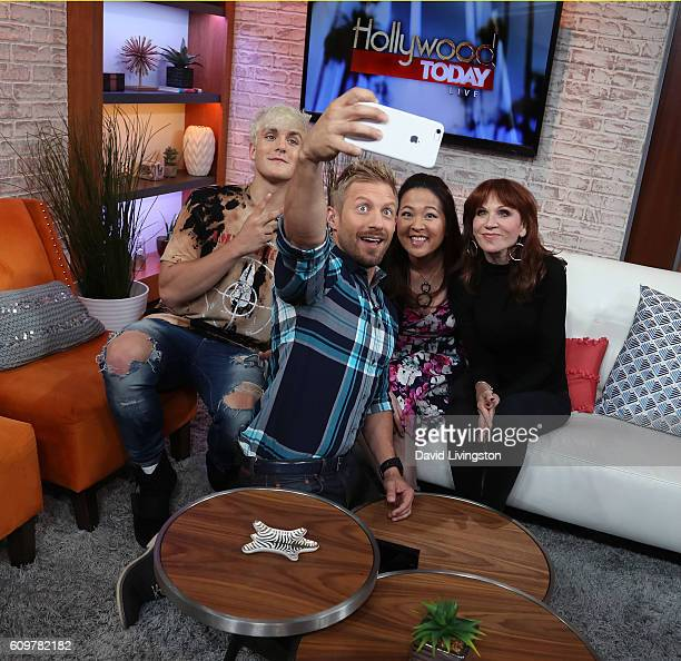 Actor/internet personality Jake Paul host Tanner Thomason and actresses Suzy Nakamura and Marilu Henner pose for a selfie at Hollywood Today Live at...