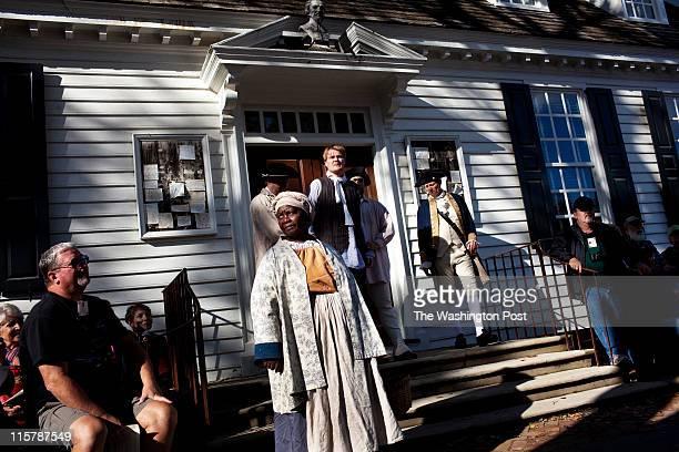 ActorInterpretors Emily James Cash Arehart Frank Megargee perform a scene in Colonial Williamsburg Virginia on Tuesday October 5 2010