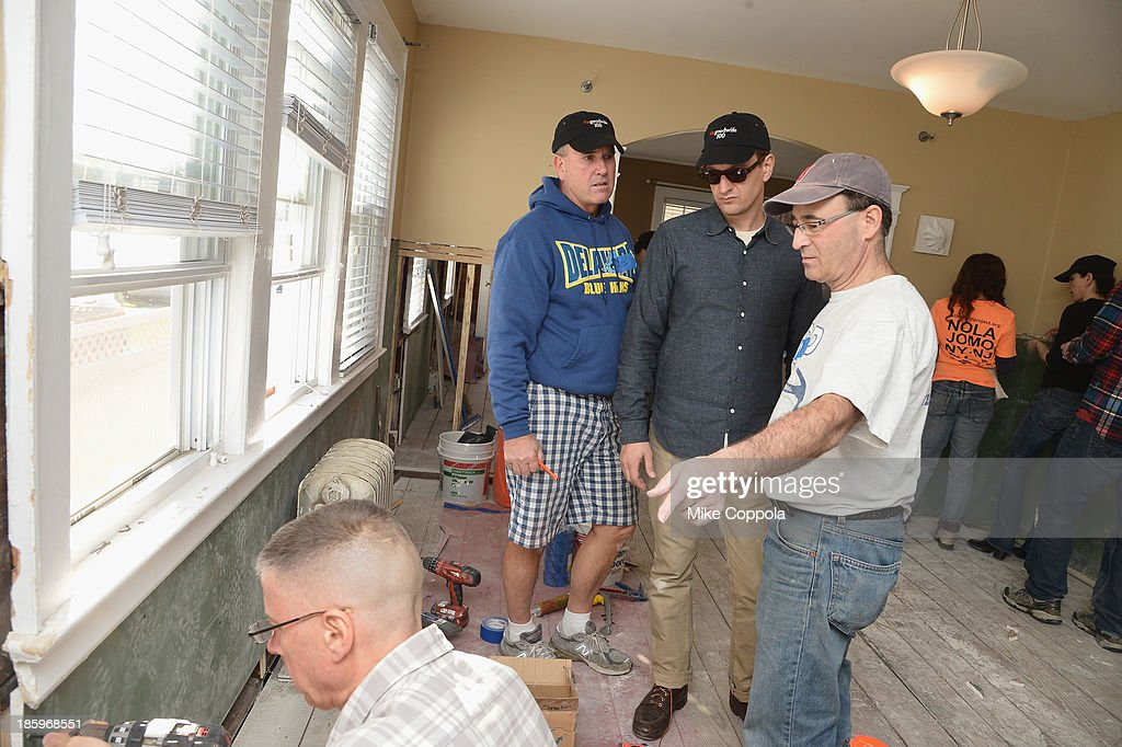 ActorJosh Charles (C) helps repair a home as The Cast Of 'The Good Wife' Celebrates Their100th Episode With A Day Of Service For The St. Bernard Projecton on October 26, 2013 in New York City.