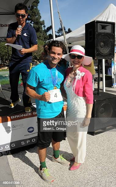 Actor/martial artist Hector David Jr of 'Power Ragers Samurai' and attorney Vicki Roberts participate in GLA ALA's 8th Annual Justice Jog to benefit...