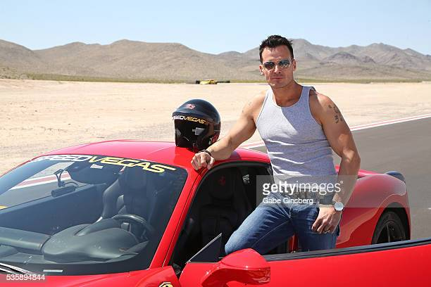 Actor/model Antonio Sabato Jr poses with a 2013 Ferrari 458 Italia at the SpeedVegas motorsports complex on May 30 2016 in Las Vegas Nevada