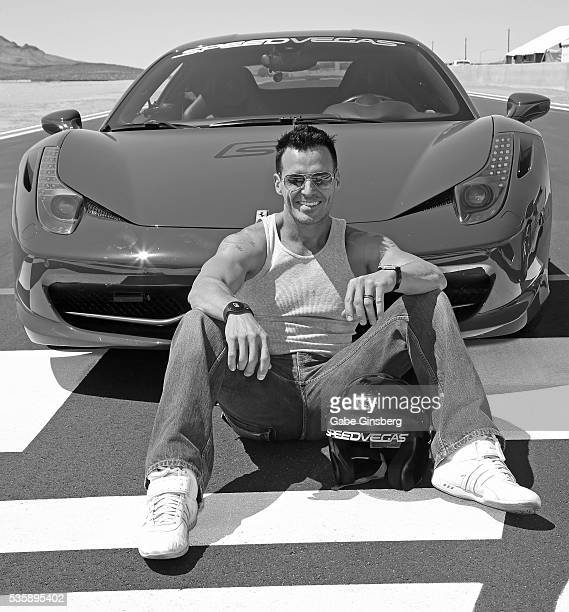 Actor/model Antonio Sabato Jr poses with a 2013 Ferrari 458 Italia at the SpeedVegas motorsports complex on May 30 2016 in Las Vegas Nevada