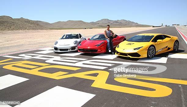 Actor/model Antonio Sabato Jr. Poses with a 2015 Porsche 911 GT3, a 2013 Ferrari 458 Italia and a 2015 Lamborghini Huracan at the SpeedVegas...