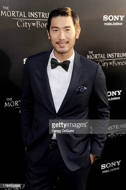 Actor/model Godfrey Gao arrives at the Los Angeles premiere of The Mortal Instruments City Of Bones at ArcLight Cinemas Cinerama Dome on August 12...