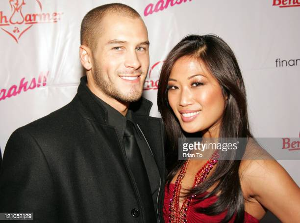 Actor/model Justin Carl and Lena arrives at the 3rd Annual Bench Warmer Trading Cards Holiday Party and Toy Drive at The Kress on December 9 2008 in...