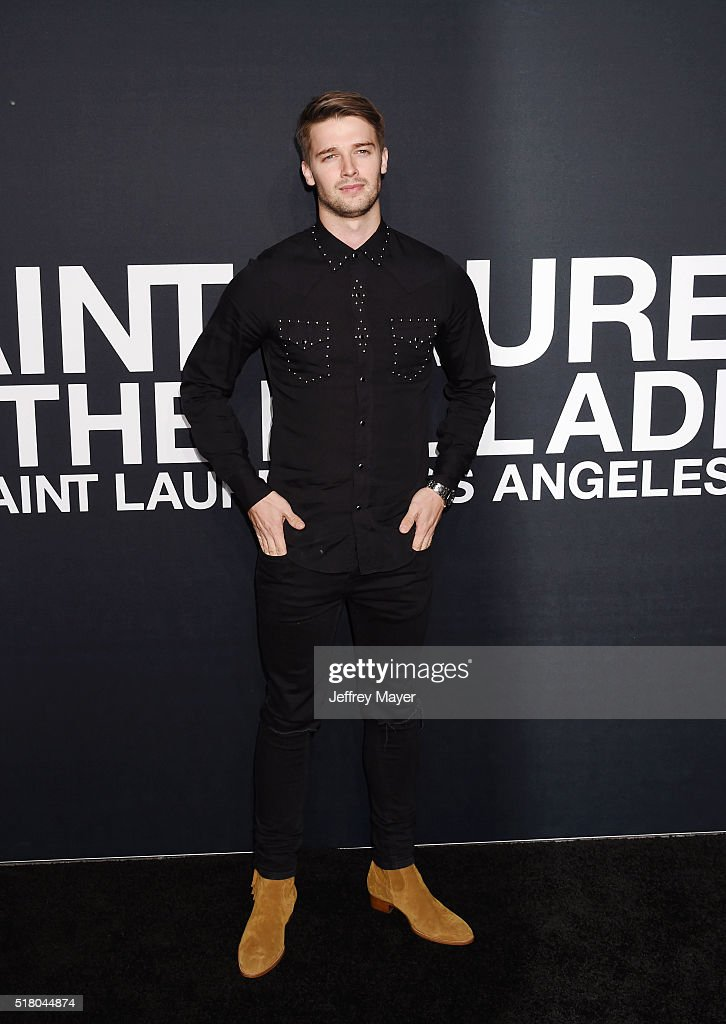 Actor/model Patrick Schwarzenegger attends the Saint Laurent show at The Hollywood Palladium on February 10, 2016 in Los Angeles, California.
