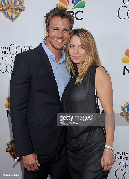 Actor/model Rusty Joiner and wife Charity Walden arrive at the premiere of Warner Bros Television's Dolly Parton's Coat Of Many Colors at the...