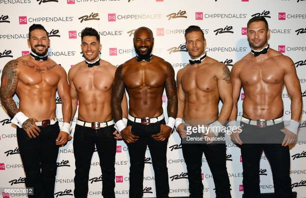 Actor/model Tyson Beckford poses for photos with the cast of Chippendales as he begins a celebrity guest host in residency with the Chippendales at...