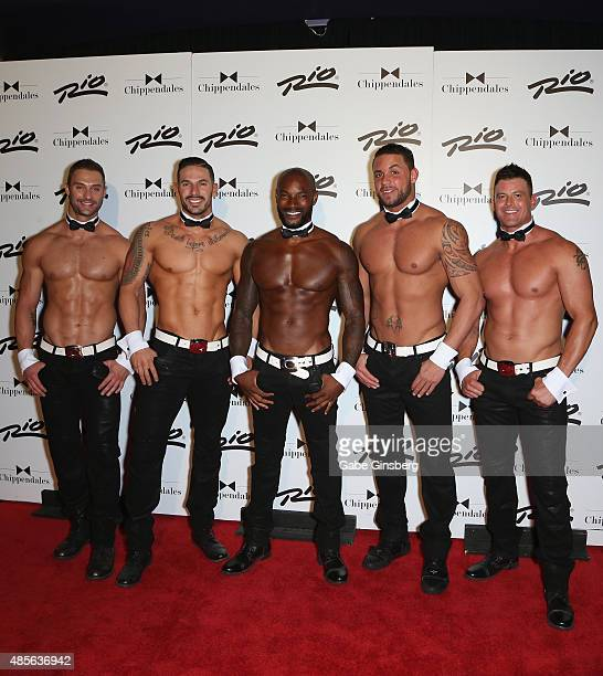 Actor/model Tyson Beckford poses with Chippendales dancers James Davis, Mikey Perez, Matt Marshall and Nathan Minor as Beckford arrives at the Rio...