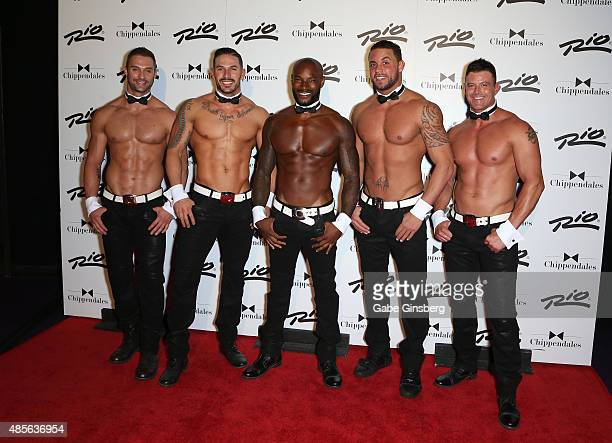Actor/model Tyson Beckford poses with Chippendales dancers James Davis Mikey Perez Matt Marshall and Nathan Minor as Beckford arrives at the Rio...