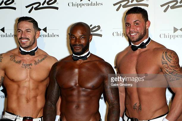 Actor/model Tyson Beckford poses with Chippendales dancers Mikey Perez and Matt Marshall as Beckford arrives at the Rio Hotel Casino to guest host...