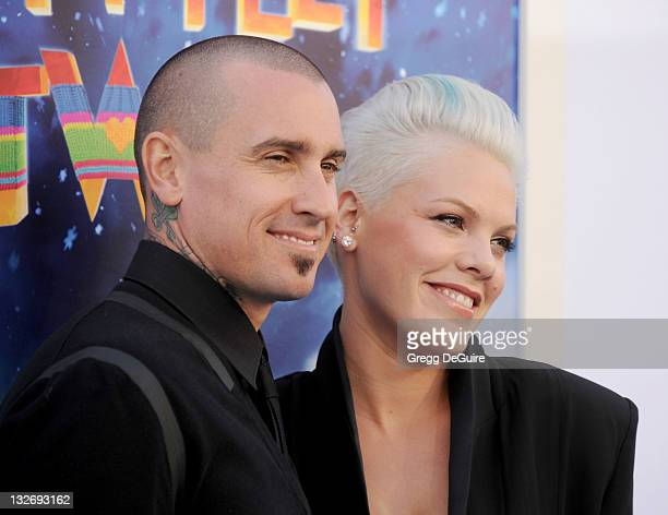 Actor/motocross rider Carey Hart and actress/recording artist Pink arrive at the 'Happy Feet Two' Los Angeles Premiere at Grauman's Chinese Theatre...