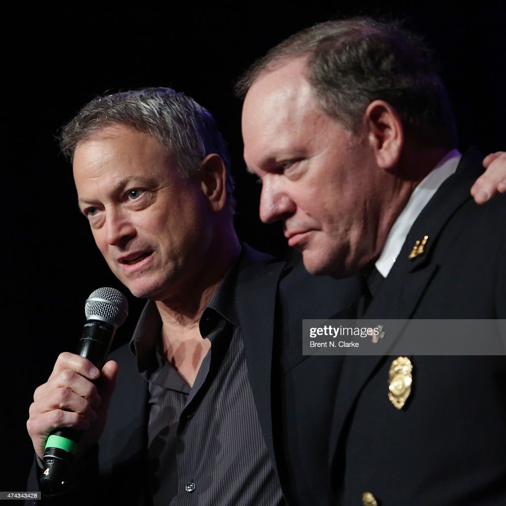 Actor/musician Gary Sinese (L) and ret. fire captain John 'Woody' Woodall appear on stage during the Rock The Boat Fleet Week Kickoff Concert held at Hard Rock Cafe, Times Square on May 21, 2015 in New York City.