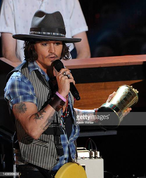 Actor/musician Johnny Depp accepts the MTV Generation Award onstage during the 2012 MTV Movie Awards held at Gibson Amphitheatre on June 3 2012 in...