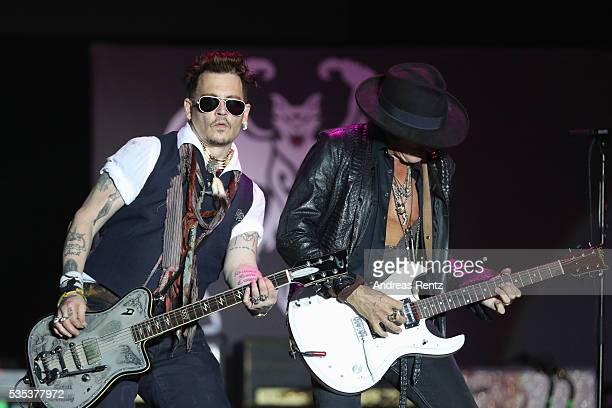Actor/Musician Johnny Depp and Musician Joe Perry of Hollywood Vampires perform onstage at HessentagsArena during the 56th Hessentag on May 29 2016...