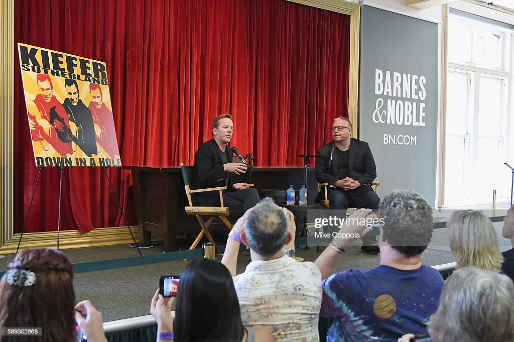 Actor/musician Kiefer Sutherland (L) speaks to an audience before signing copies of his new book 'Down In A Hole' at Barnes & Noble Union Square on August 13, 2016 in New York City.