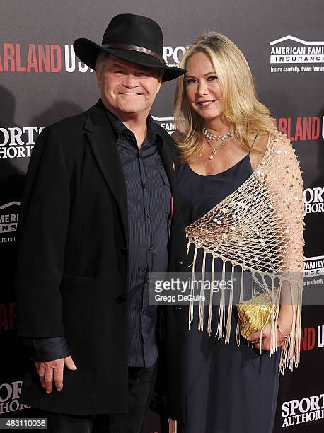 Actor/musician Micky Dolenz and Donna Quinter arrive at the World Premiere of Disney's McFarland USA at the El Capitan Theatre on February 9 2015 in...