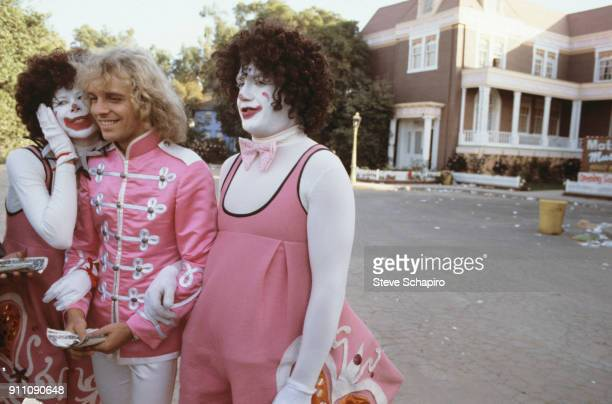 Actor/musician Peter Frampton with two unidentified actors in clown costumes on the set of their film 'Sgt Pepper's Lonely Hearts Club Band' Los...