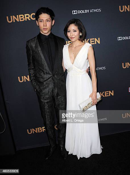 "Actor/musician Takamasa Ishihara AKA Miyavi and wife Melody Ishihara arrive for the Premiere Of Universal Studios' ""Unbroken"" held at The Dolby..."