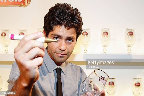 Actor/producer Adrian Grenier signs a chalice in support of Stella Artois and Water.org's #buyaladyadrink campaign during '52: The Search for the...