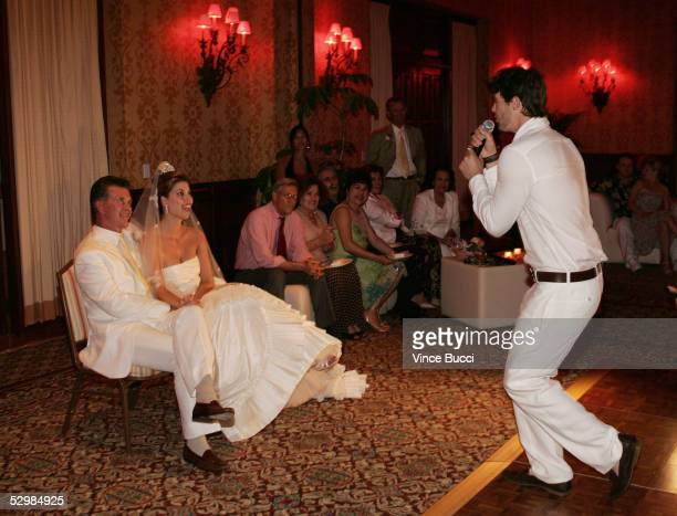 Actor/producer Alan Thicke and model Tanya Callau listen as Thicke's son Robin sings to them at their wedding reception on May 7 2005 at The OneOnly...