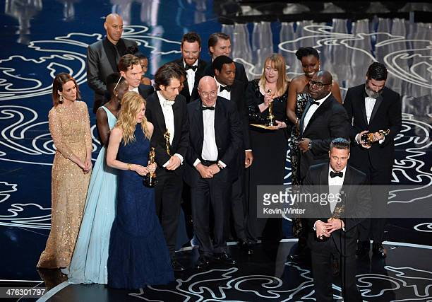 Actor/producer Brad Pitt accepts the Best Picture award for '12 Years a Slave' with actors Sarah Paulson Benedict Cumberbatch Lupita Nyong'o...