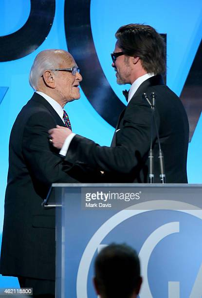 Actor/producer Brad Pitt accepts the PGA Visionary Award from producer Norman Lear onstage during the 26th Annual Producers Guild Of America Awards...