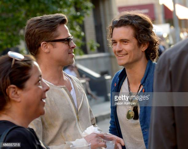 Actor/producer Brad Pitt and actor Orlando Bloom attend the Paris Photo Los Angeles private preview at Paramount Studios on April 24 2014 in...