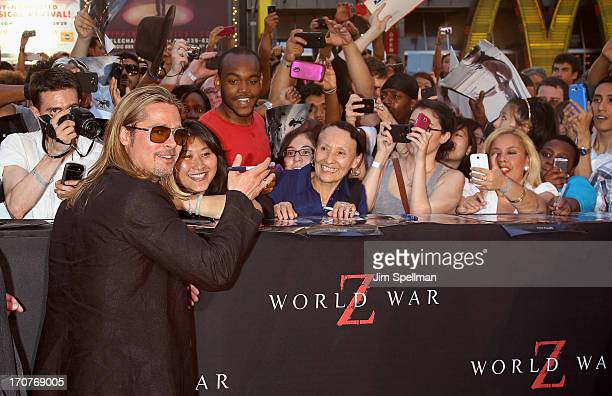 """Actor/producer Brad Pitt and fans attend """"World War Z"""" New York Premiere on June 17, 2013 in New York City."""