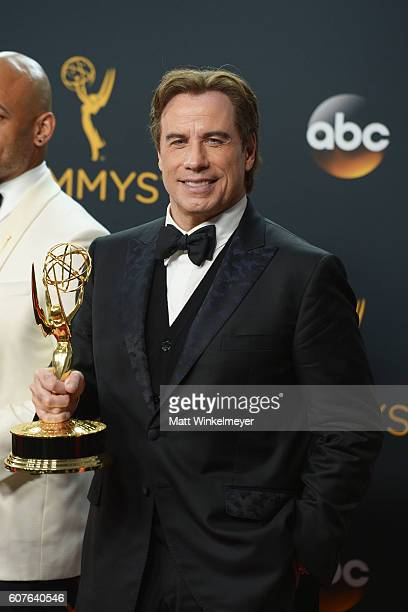Actor/producer John Travolta winner of the Outstanding Limited Series award for 'The People vs OJ Simpson American Crime Story' poses in the press...