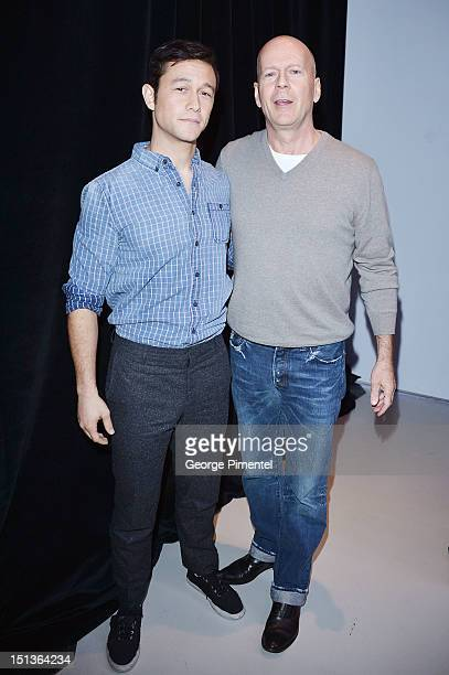 Actor/producer Joseph GordonLevitt and Bruce Willis attend the Guess Portrait Studio on Day 1 during the 2012 Toronto International Film Festival at...