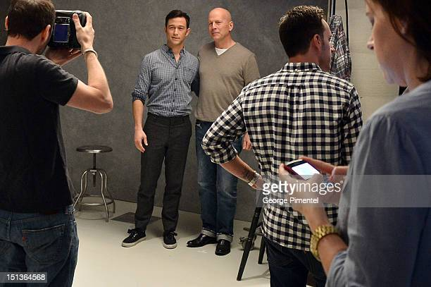 Actor/producer Joseph GordonLevitt and Bruce Willis pose for photographer Jeff Vespa at the Guess Portrait Studio on Day 1 during the 2012 Toronto...