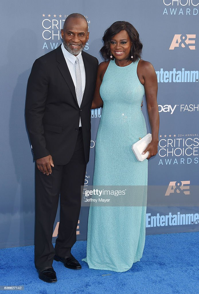 Actor-producer Julius Tennon (L) and actress Viola Davis arrive at The 22nd Annual Critics' Choice Awards at Barker Hangar on December 11, 2016 in Santa Monica, California.