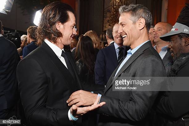 Actorproducer Mark Wahlberg and talent agent and CoCEO of William Morris Endeavor Ari Emanuel attend the premiere of Patriots Day at AFI Fest 2016...