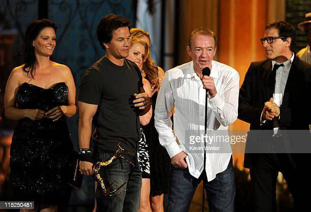 """Actor-producer Mark Wahlberg, boxing trainer Dicky Eklund and director David O. Russell accept the Guy Movie of the Year award for """"The Fighter""""..."""