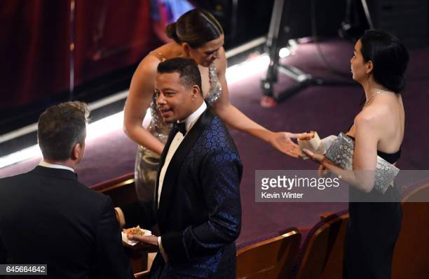 Actor/producer Matt Damon and actor Terrence Howard in the audience during the 89th Annual Academy Awards at Hollywood Highland Center on February 26...