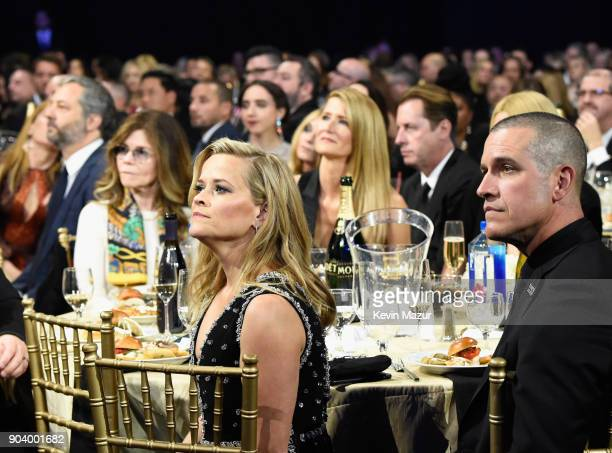 Actorproducer Reese Witherspoon and talent agent Jim Toth attend The 23rd Annual Critics' Choice Awards at Barker Hangar on January 11 2018 in Santa...