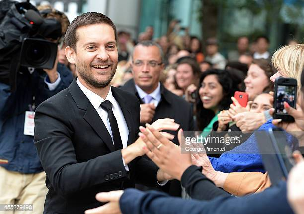 Actor/producer Tobey Maguire greets fans as he attends the Pawn Sacrifice premiere during the 2014 Toronto International Film Festival at Roy Thomson...