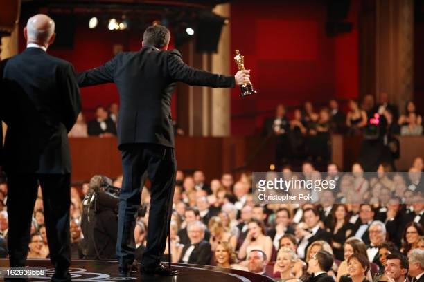Actorproducerdirector Ben Affleck accepts the Best Picture award for 'Argo' seen from backstage during the Oscars held at the Dolby Theatre on...