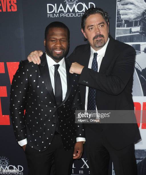 Actor/rapper Curtis Jackson and director Christian Gudegast arrive for the Premiere Of STX Films' 'Den Of Thieves' held at Regal LA Live Stadium 14...