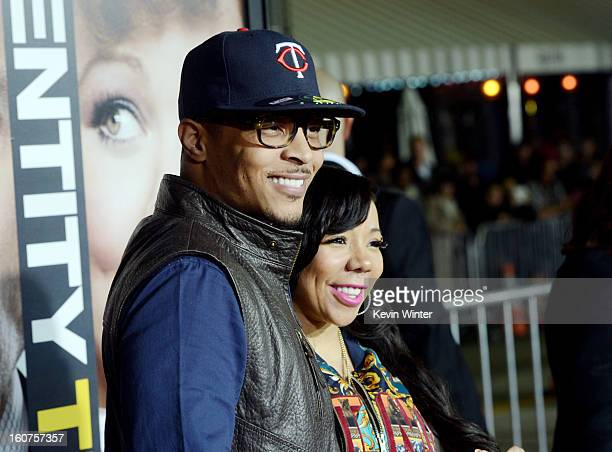 Actor/rapper TI and his wife Tiny arrive at the premiere of Universal Pictures' 'Identity Thief' at the Village Theatre on February 4 2013 in Los...