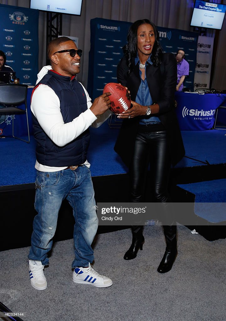 Actor/recording artist Jamie Foxx and former WNBA player Lisa Leslie attend SiriusXM at Super Bowl XLIX Radio Row at the Phoenix Convention Center on January 30, 2015 in Phoenix, Arizona.