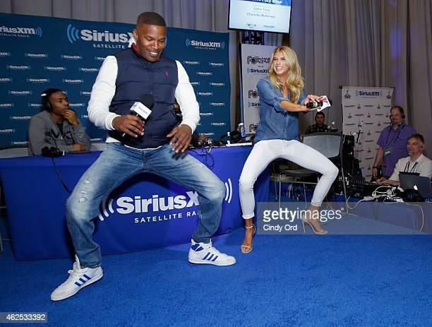 Actor/recording artist Jamie Foxx and model Charlotte McKinney attend SiriusXM at Super Bowl XLIX Radio Row at the Phoenix Convention Center on...