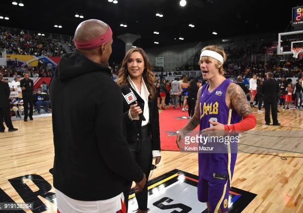 Actor/recording artist Jamie Foxx and recording artist Justin Bieber speak during the NBA AllStar Celebrity Game 2018 presented by Ruffles at Verizon...