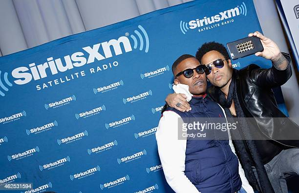 Actor/recording artist Jamie Foxx and recording artist Lenny Kravitz attend SiriusXM at Super Bowl XLIX Radio Row at the Phoenix Convention Center on...