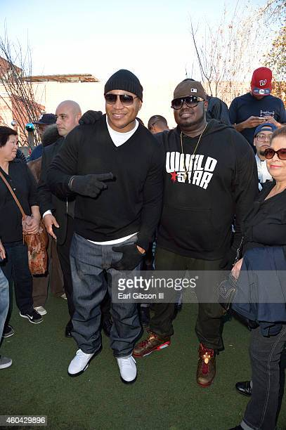 Actor/Recording Artist LL Cool J and Founder CEO of World Star Hip Hop Lee 'Q' O'Denat pose for a photo at The Worldstar Foundations 2nd Annual Skid...