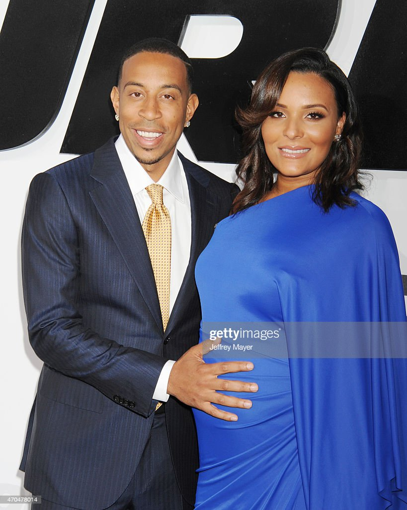 Actor/recording artist Ludacris (L) and Eudoxie Mbouguiengue arrive at the 'Furious 7' - Los Angeles Premiere at TCL Chinese Theatre IMAX on April 1, 2015 in Hollywood, California.
